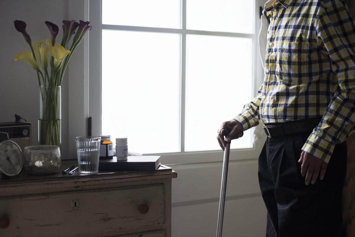 fragile senior with cane
